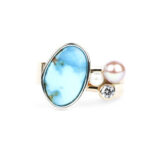 Picture of a turquoise, pearl, and diamond mixed metal ring.