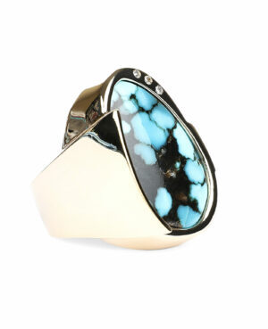 Side profile of turquoise, diamond, and gold ring.