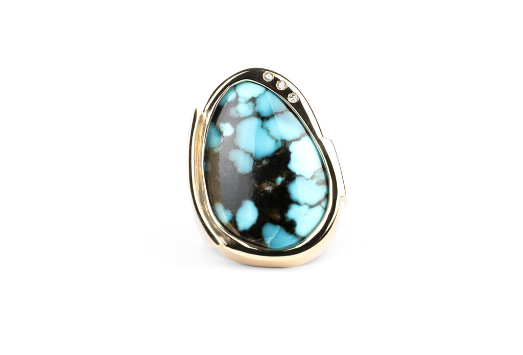 Turquoise, diamond, and gold ring.