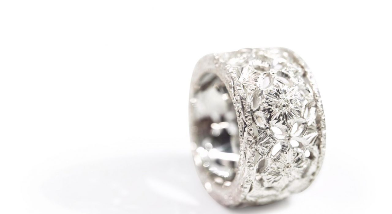 Sterling silver ring with cut of leaf details and engraving.